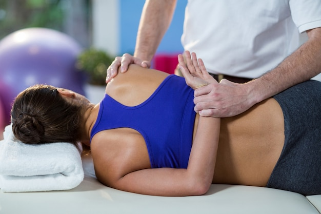 Woman receiving arm massage from physiotherapist