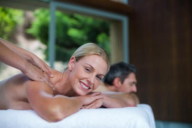 Woman receiving back massage from masseur