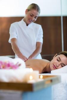 Woman receiving a back massage