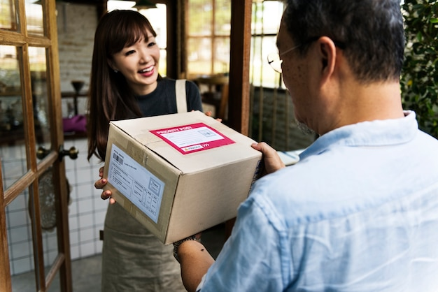 Woman receiving a box delivered to her
