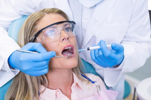 Woman receiving dental treatment at medical clinic