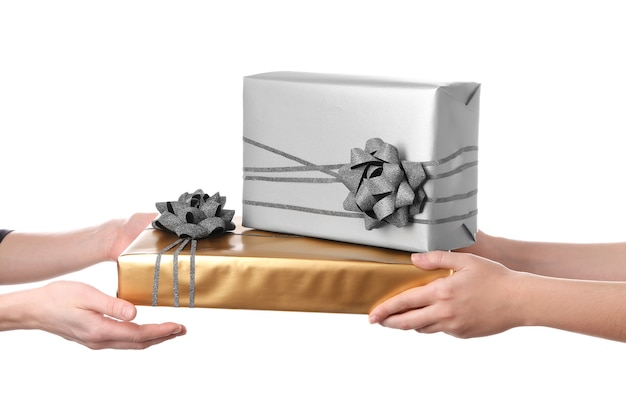 Woman receiving gift boxes from her friend
