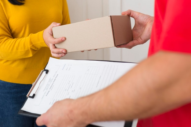 Woman receiving her new cyber monday purchase close-up