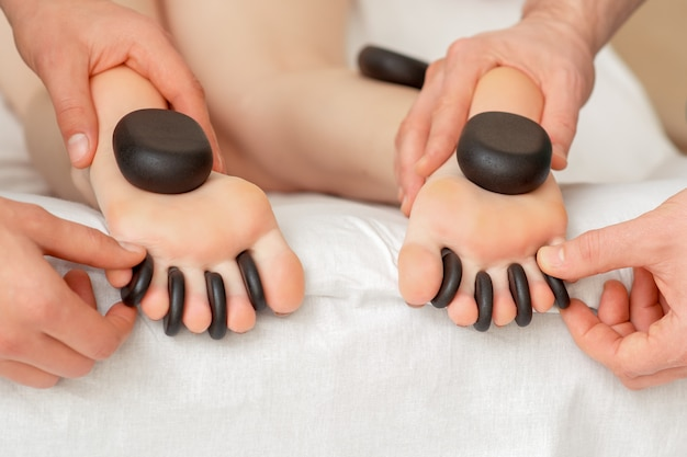 Woman receiving hot stone massage.