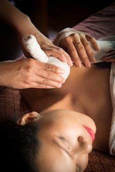 Woman receiving a massage on the clavicle