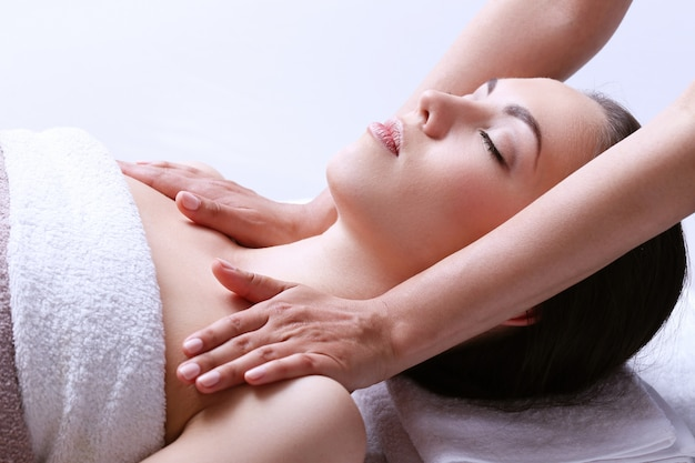 Woman receiving massage on a spa center