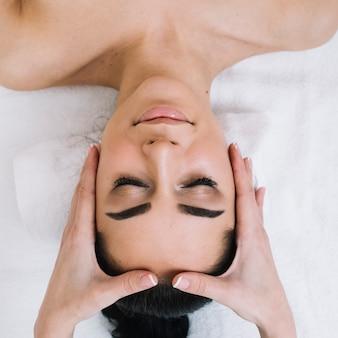 Woman receiving a relaxing facial massage