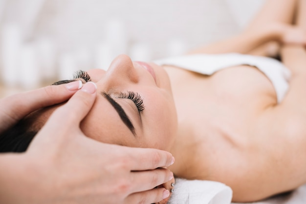 Woman receiving a relaxing facial massage