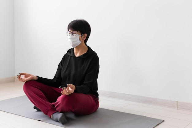 Woman recovering after coronavirus with meditation