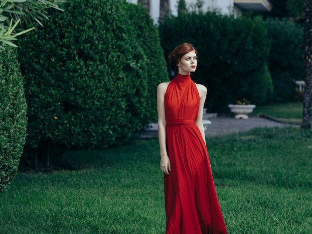 Woman in red dress green grass park luxury charm model.