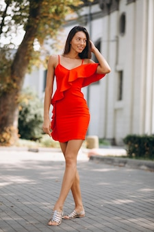 Woman in red dress outside in town