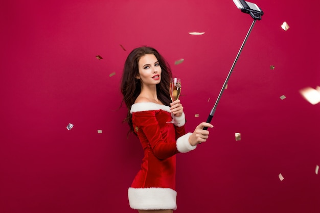 Woman in red dress taking selfie