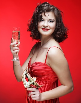 Woman in red dress with glass of champagne