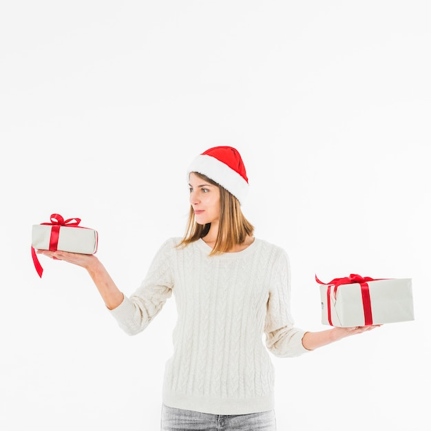 Woman in red santa hat with gift boxes