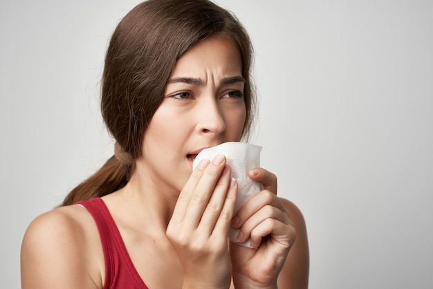 Woman in red tshirt cold handkerchief health problems