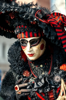 Woman in red venetian carnival costume