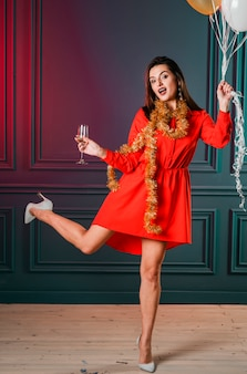 Woman in red with champagne glass