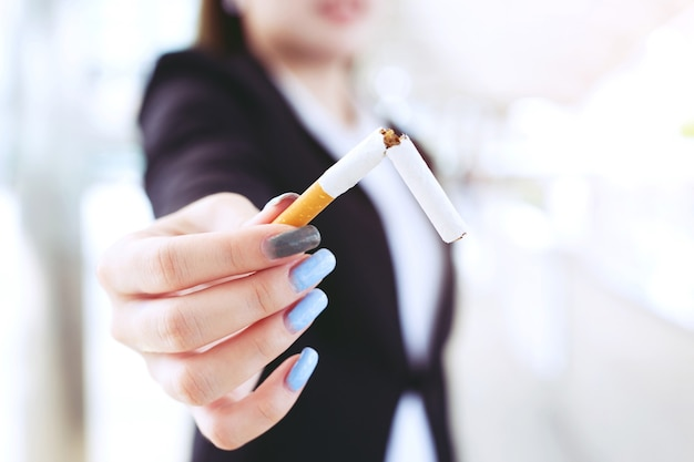 Woman refusing cigarettes concept for quitting smoking and healthy lifestyle