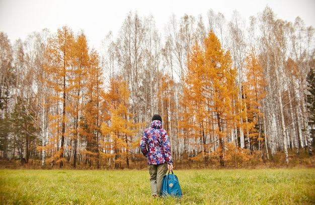 Woman rejoices at arrival of autumn. girl in field