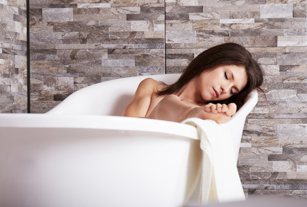 Woman relax in bath tube