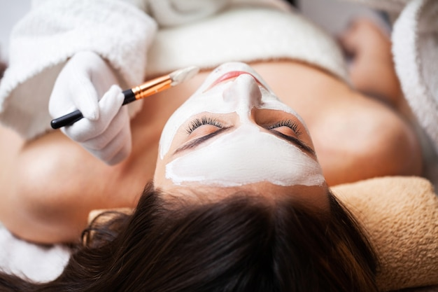 Woman relaxes during spa treatments at beauty salon