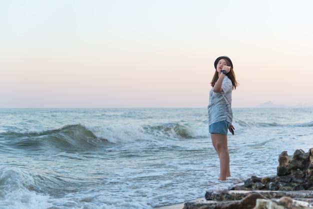 Woman relaxes at sea beach
