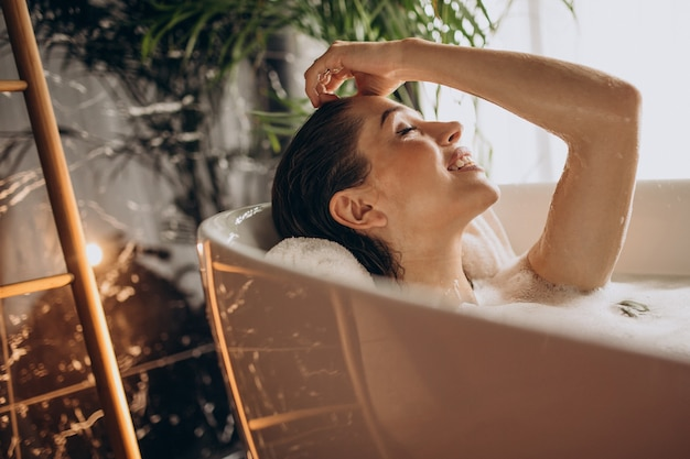 Woman relaxing in bath with bubbles