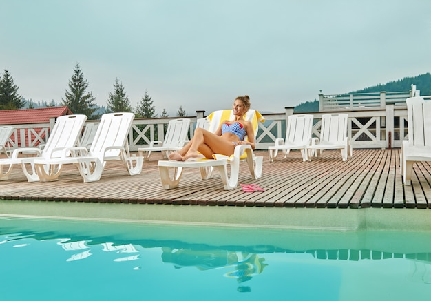 Woman relaxing on beach chair during summer vacation.