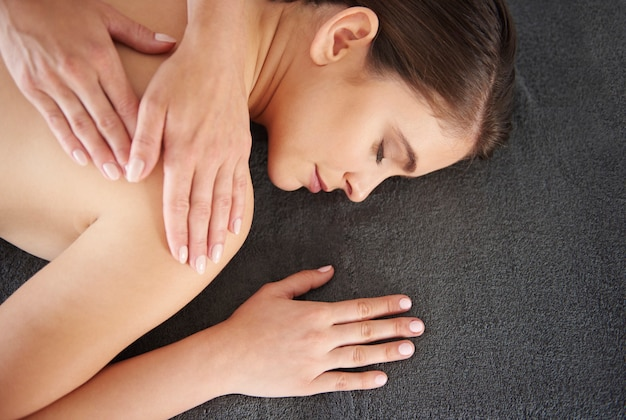 Woman relaxing during the massaging