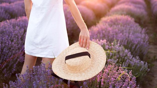 Woman relaxing in flower field