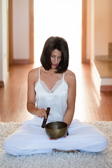 Woman relaxing at home while practicing yoga