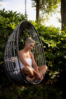 Woman relaxing at a spa hotel outside