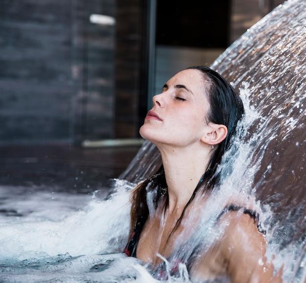 Woman relaxing in spa