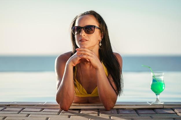 Woman relaxing in swimming pool water
