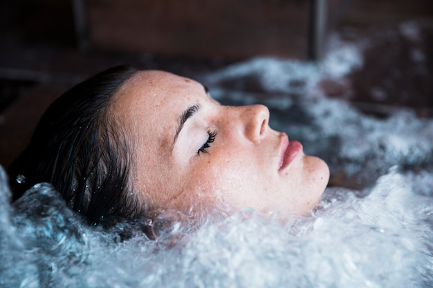 Woman relaxing in whirlpool