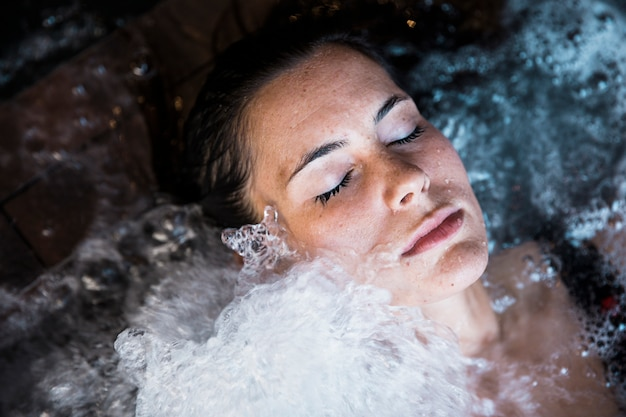 Woman relaxing in whirlpool