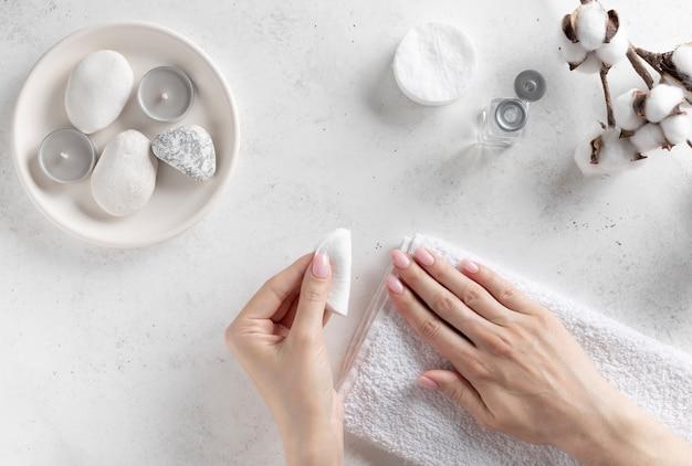 Woman removing nail polish with a cotton pad Premium Photo
