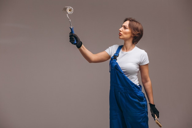 Woman repairer with painting roller isolated