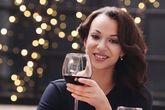 Woman in restaurant holding a wine glass
