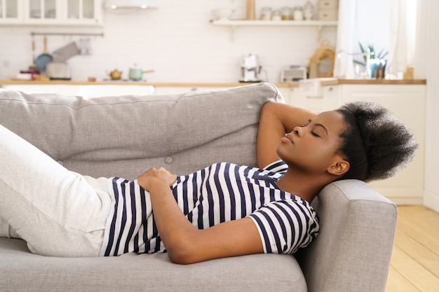 Woman resting sleeping on couch at home