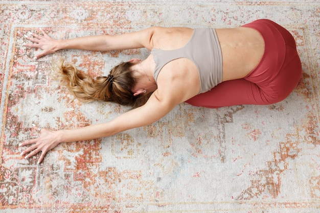 Woman rests after yoga in pose