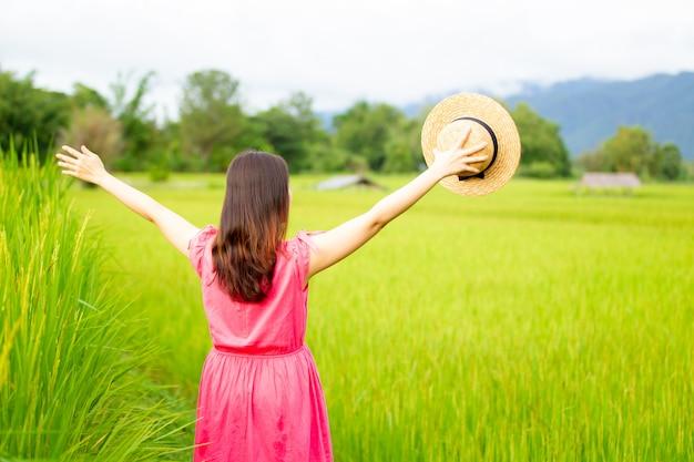 Woman in rice field.