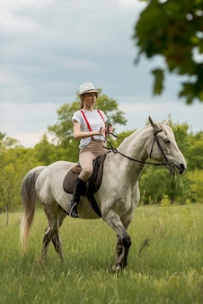 Woman ridding a horse in the countryside