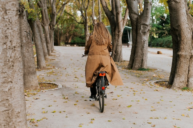 Woman riding the bicycle from behind shot