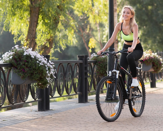 Woman riding a bike surrounded by nature