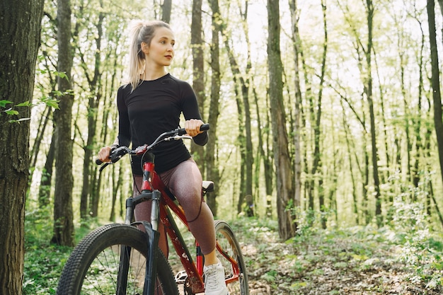 Woman riding a mountain bike in the forest