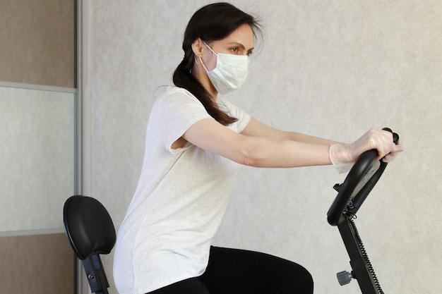 Woman riding a stationary bike at home