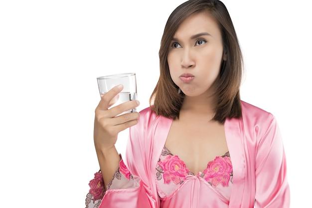 Woman rinsing and gargling while using mouthwash