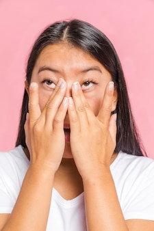 Woman rubs her eyes and looking away