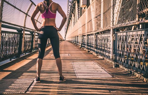 Woman runner on the manhattan bridge
